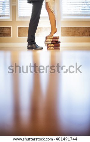 bride and groom silhouettes in the house  - stock photo