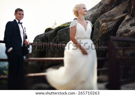 bride and groom smiling on the background of mountains