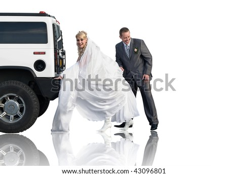 Bride and groom stand behind car and try to push it. Isolated on white background. - stock photo
