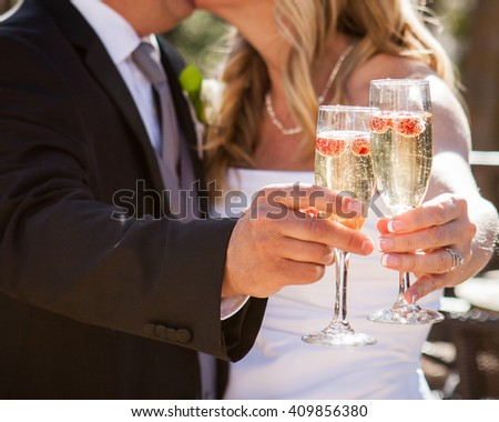 bride and groom toasting champagne - stock photo