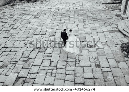 bride and groom walking - stock photo