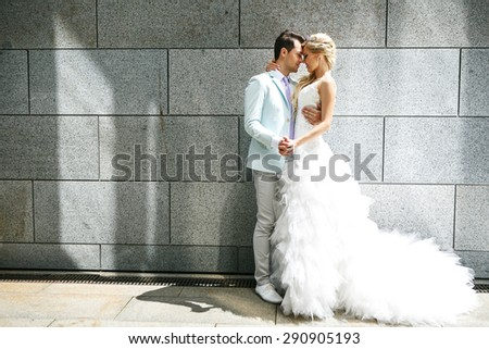 Bride and groom walking around among the houses and buildings
