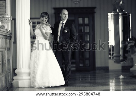 bride and groom wedding black and white portrait indoors