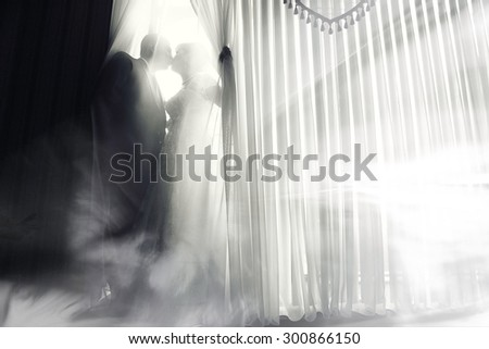bride and groom wedding black and white portrait indoors - stock photo