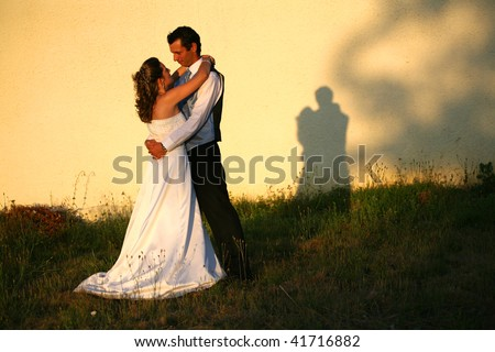 bride and groom, wedding day, in the park - stock photo