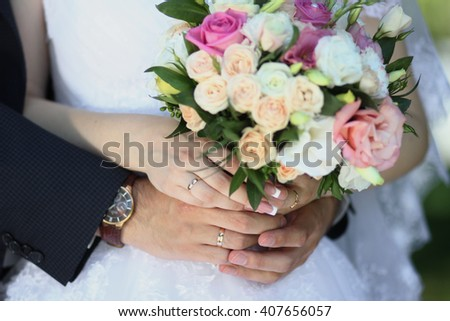 Bride and groom with a bouquet of flowers
