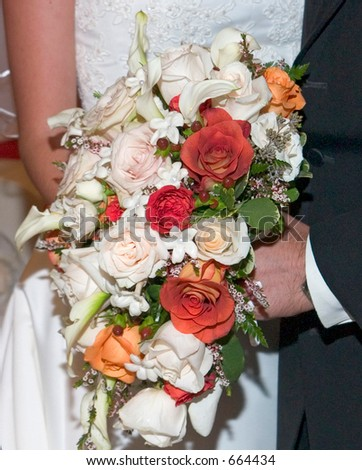 Bride and groom with flowers.
