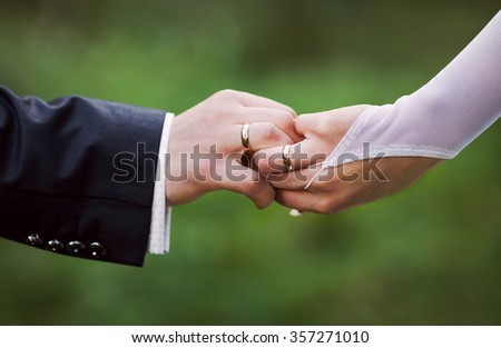 Bride and groom with wedding rings on their hands, male and female hand with wedding rings, wedding ceremony, together forever - stock photo