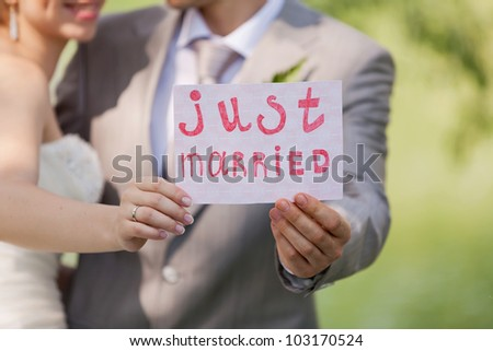 Bride and nevesat with a sign just married - stock photo