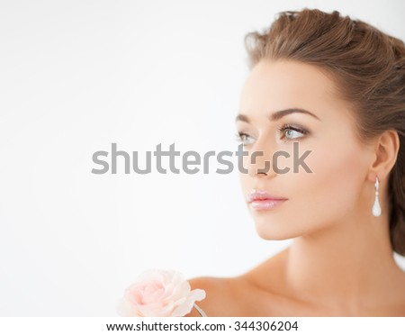 bride and wedding concept - young woman with rose flower - stock photo