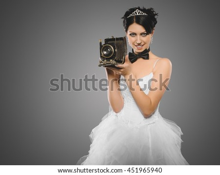 bride as a wedding photographer with the old vintage camera