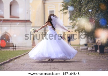 bride at a wedding in a white dress - stock photo