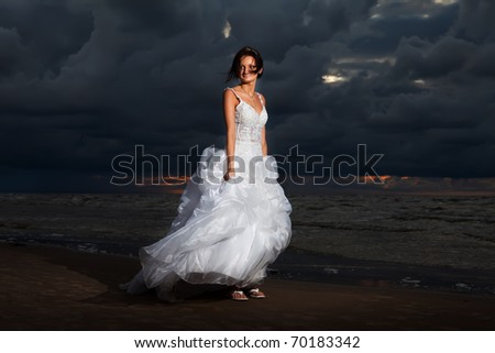 Bride at night on the beach