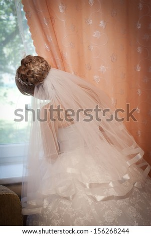 Bride at the window  - stock photo