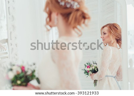 bride at wedding morning in a mirror reflection