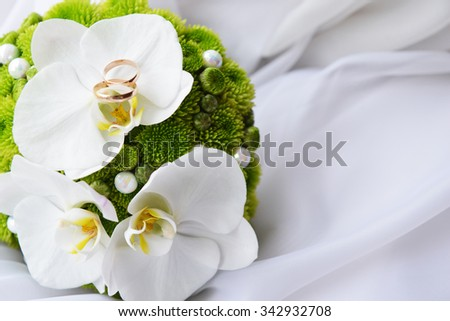 bride bouquet and  wedding  gold rings - stock photo
