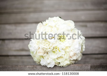 bride bouquet white - on organic unpainted wood planks - stock photo