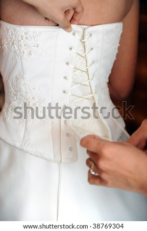 Bride dressing up - stock photo