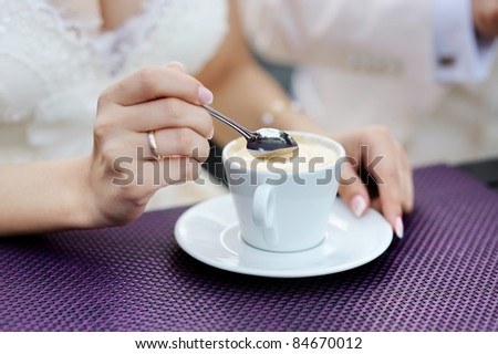 Bride drinking coffee at a wedding day - stock photo