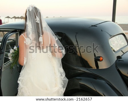 Bride entering car
