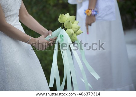 Bride from behind throw the bouquet from green  lotus  - stock photo