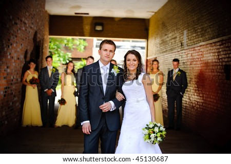 Bride, groom and bridal party - stock photo