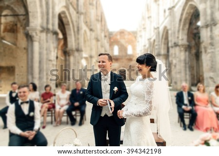 Bride, groom and guests on the outdoors wedding ceremony - stock photo