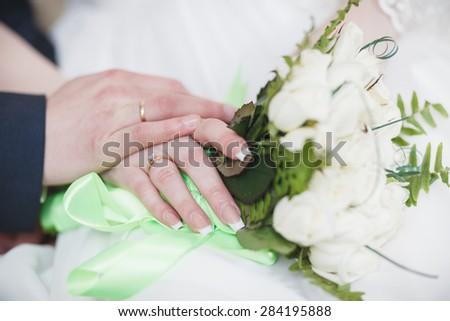 bride groom hands wedding  white dress suite - stock photo