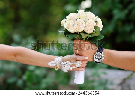 bride groom sends the bouquet of white roses wedding. - stock photo