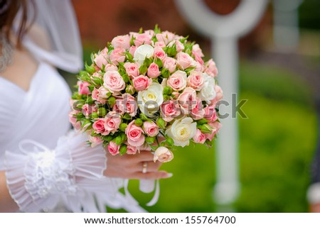 bride hold beautiful wedding bouquet