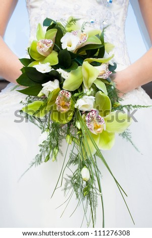 bride holding a bouquet of flowers on her wedding day - stock photo