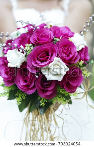 Bride Holding A Purple And White Wedding Bouquet Of Flowers With