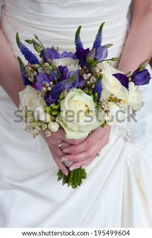 bride holding a wedding bouquet - stock photo