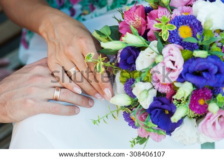 Bride holding beautiful wedding bouquet.