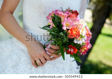 Bride holding big wedding bouquet on ceremony.