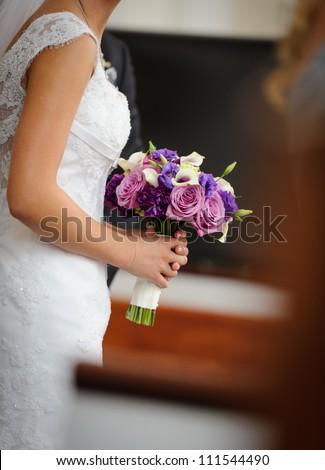 Bride holding bouquet - stock photo