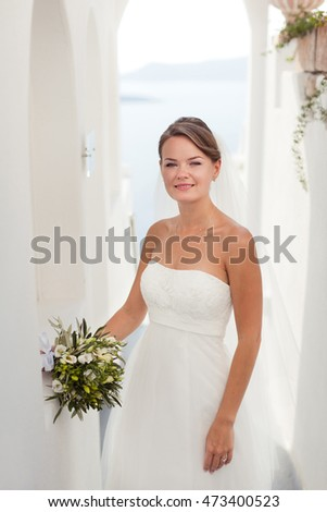 bride holding bouquet.Greece Santorini.
