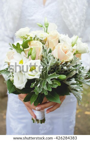 bride holding bouquet in hands beautiful white