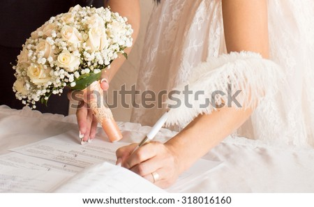 Bride holding bridal bouquet - stock photo