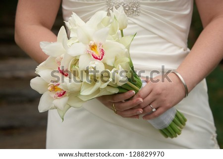 Bride holding calla lily wedding bouquet