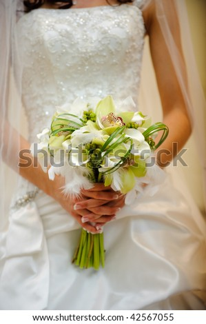 Bride holding flowers - stock photo