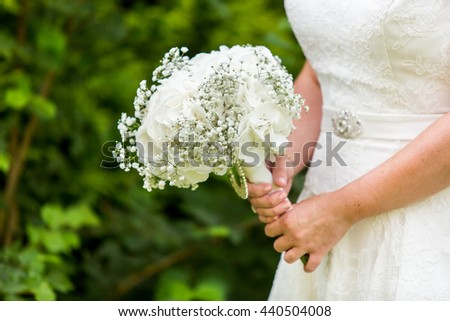 Bride holding Hydrangea, Gypsophila bouquet. Wedding flowers. Bridal white flowers bouquet. Wedding.  - stock photo
