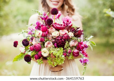 Bride holding purple boho bouquet