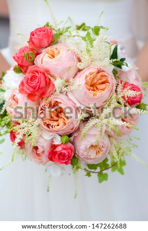 Bride holding wedding bouquet - stock photo