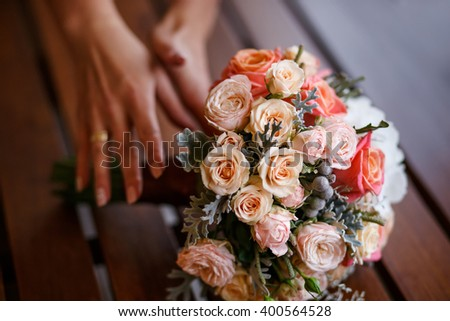 Bride holding wedding bouquet of various flowers