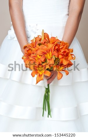 Bride holding wedding bouquet. Wedding bouquet of lilies - stock photo