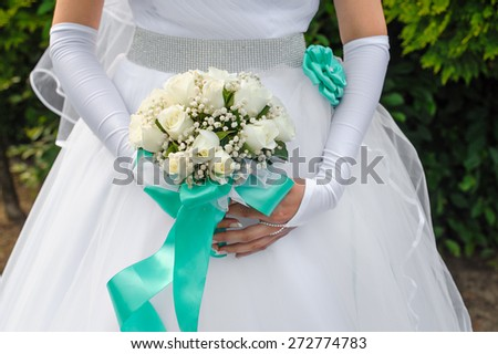 bride holds a beautiful wedding bouquet.