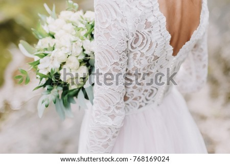 Wedding stock images royalty free images vectors shutterstock bride holds a wedding bouquet wedding dress wedding details junglespirit Choice Image