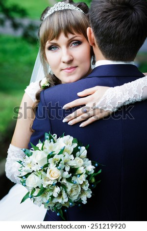 Bride hugging groom. - stock photo