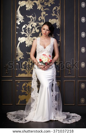 Bride in a beautiful white dress, indoor shot  - stock photo